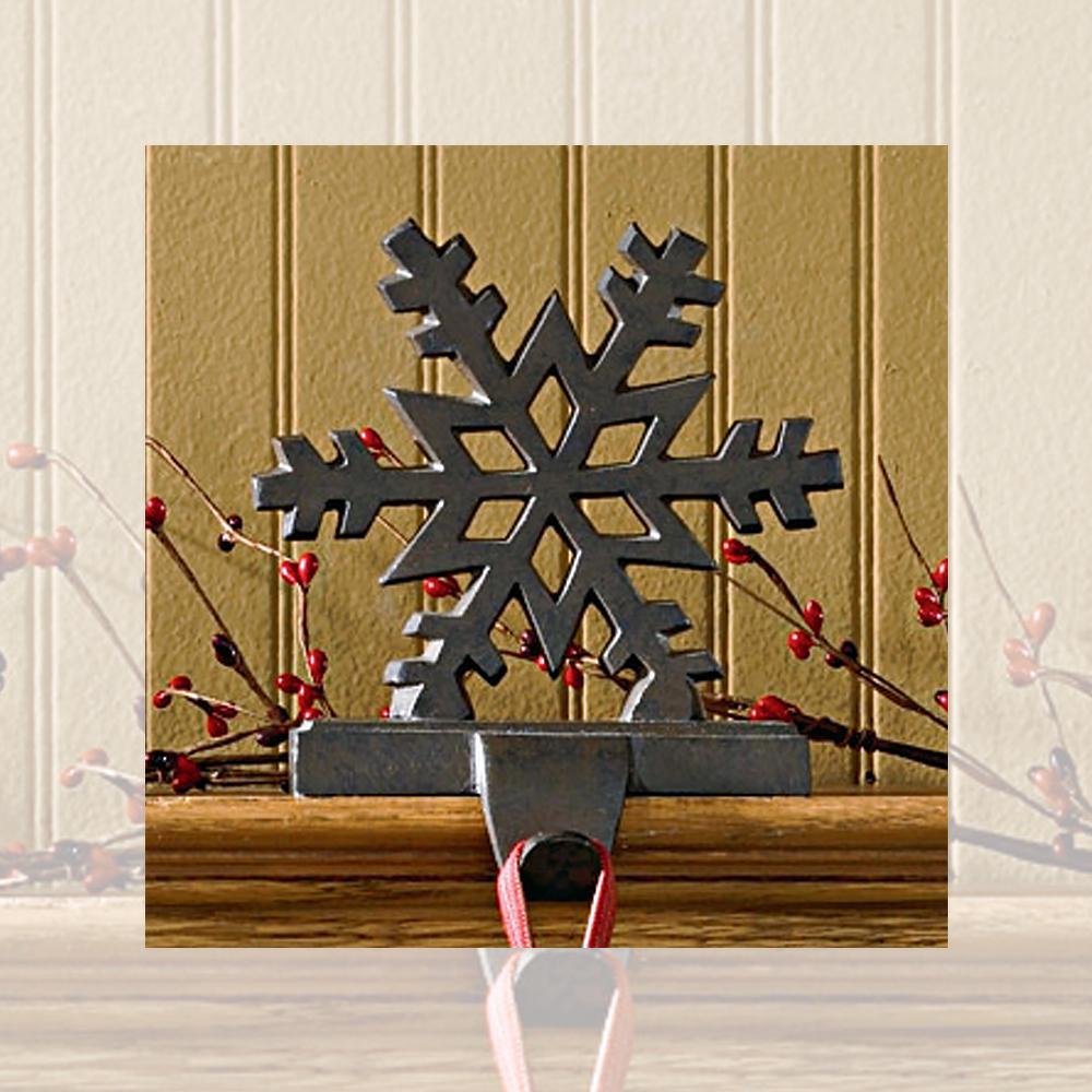 Snowflake stocking hanger holder cast iron black or white