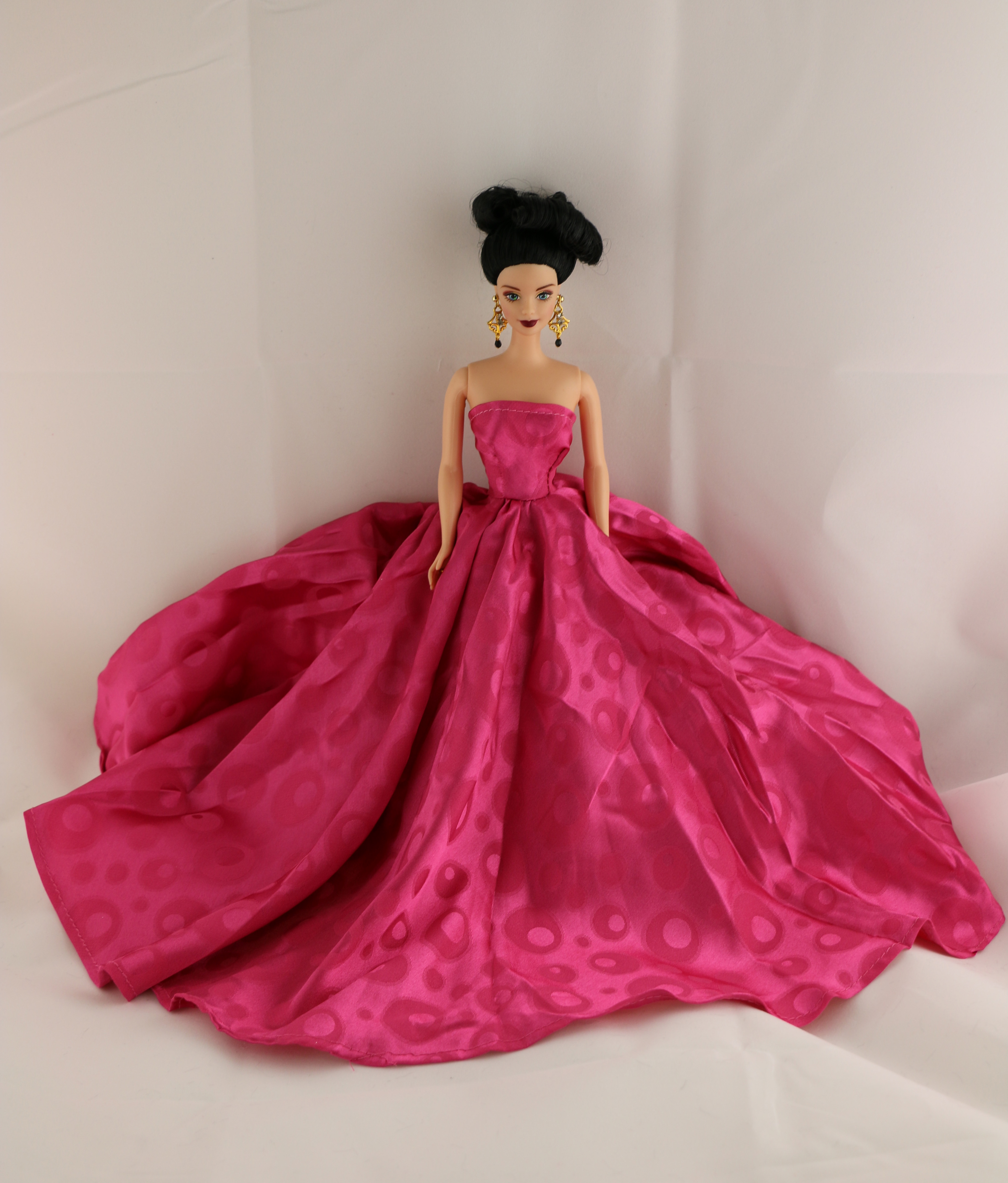 A Long Gown in Bold Pink with a Circle Patterned Fabric Made to Fit Barbie Doll