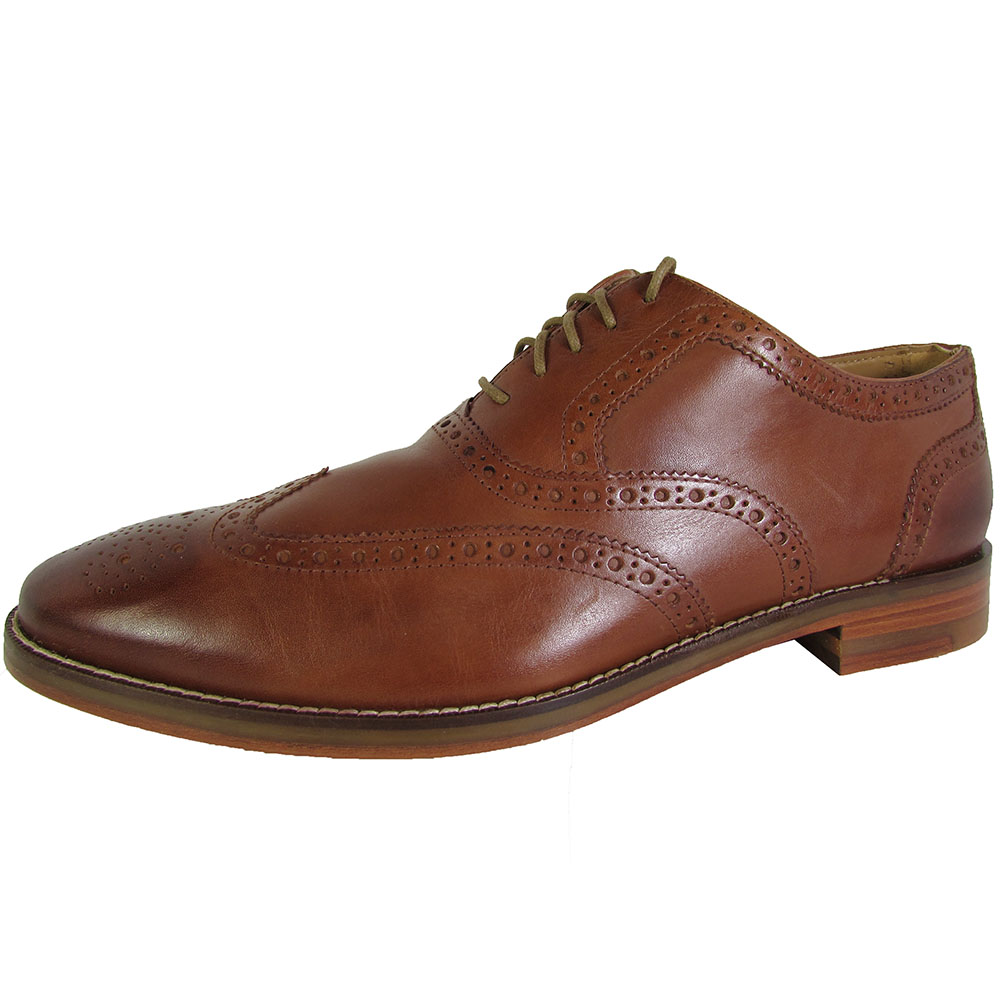 Shop for men's dress shoes to match your suit. See the latest styles like italian dress shoes and popular colors like black & brown at Men's Wearhouse! Featuring brogued details throughout, these classic wingtip shoes by Joseph Abboud are a men's dress wear must-have. With supple genuine leather uppers, a lightly cushioned insole, and.