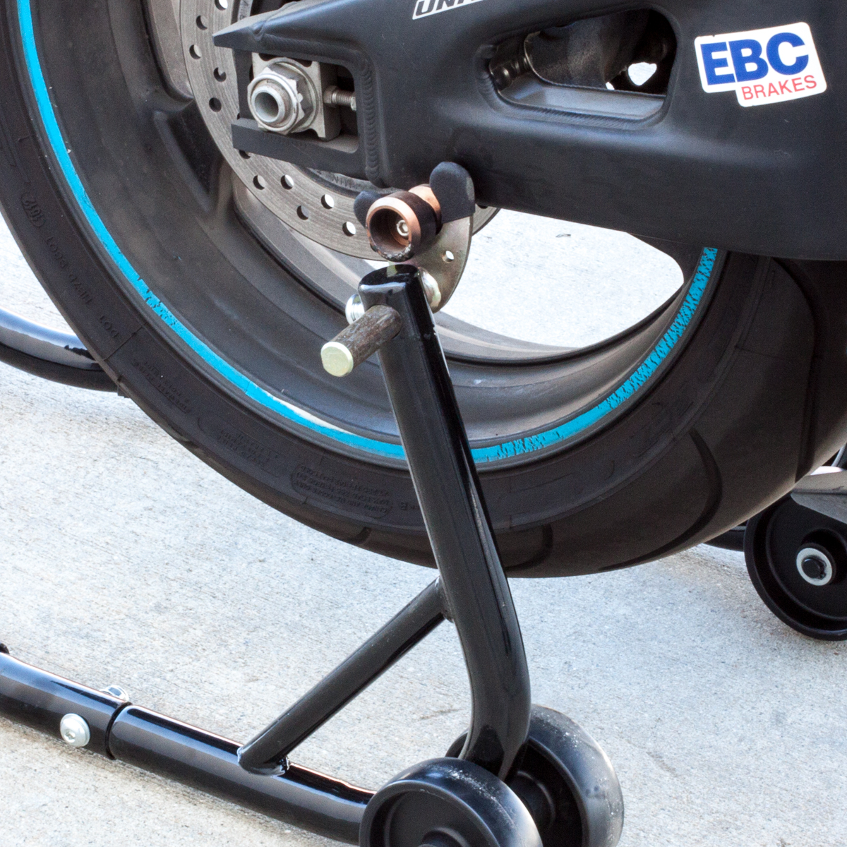 Wheel Lift Swing : Black motorcycle stand front and rear wheel lift paddock