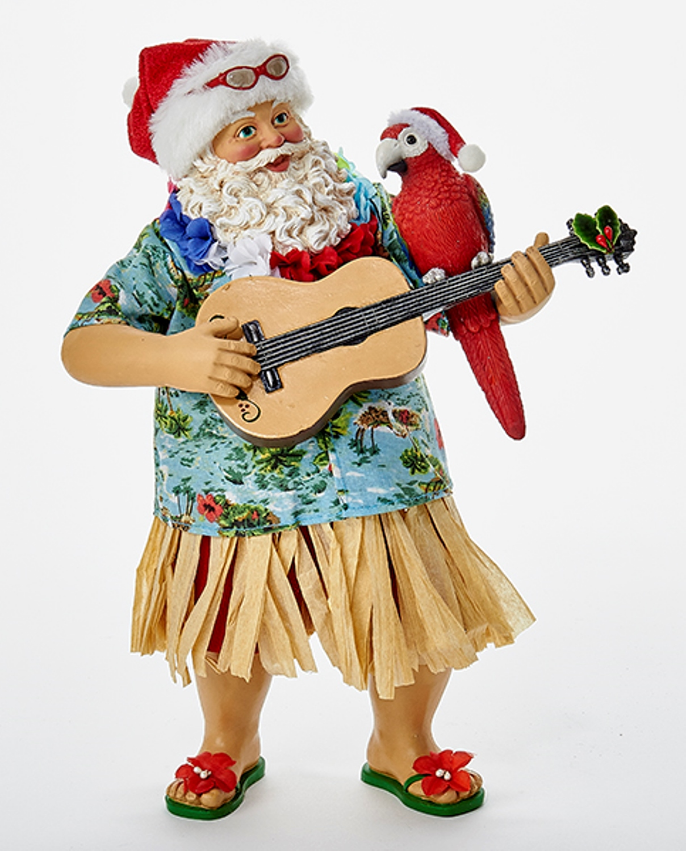 Beach santa in hula skirt playing ukulele tabletop