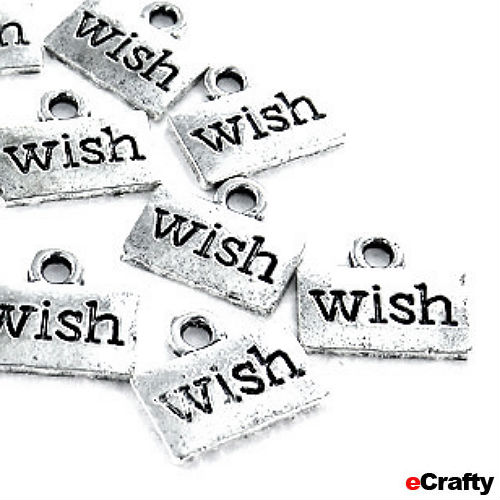http://www.ecrafty.com/p-684-10-pack-dream-charms-silver-plated-pewter-18mm-ovals.aspx