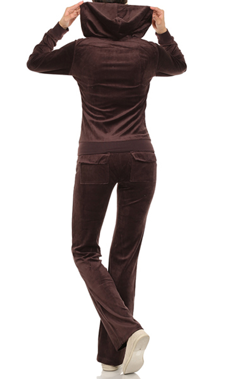 This is a very pretty velour pant suit in a plumbish (raisin) color. It is sort of half way inbetween. The buttons are unique too, They look like knotted threads.