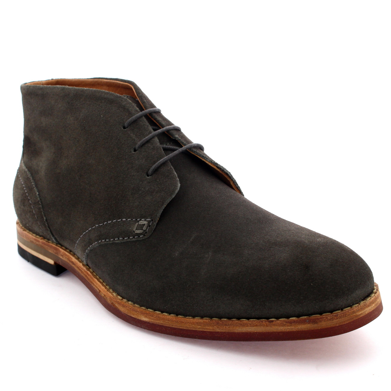 Tommy Hilfiger Essential Suede Chukka Boots. Update your casual looks with the Essential Suede boot from Tommy Hilfiger. Showcasing a soft suede upper a round toe and lace fastenings.