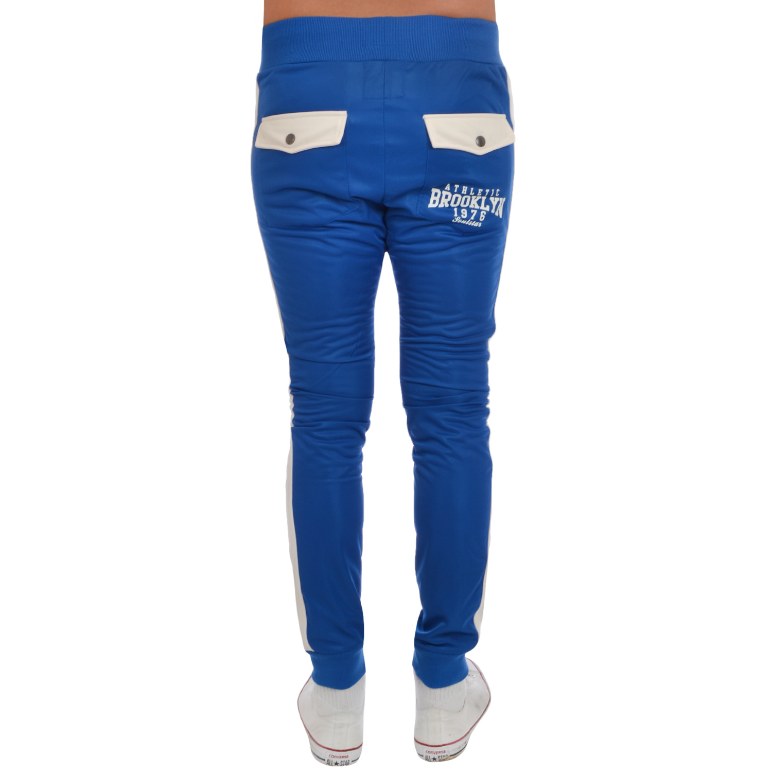 SST Slim-Fit Track Pants;Sporty track pants with three-stripes and pintuck details. Elasticized waist with belt loops. Zip fly with button closure. Side welt pockets. Slim-fit. Polyester/cotton/elastane. Machine wash. Imported. Model shown is 5'10