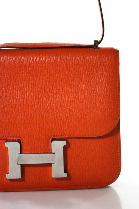 bb6b4688a15a Hermes Orange Clemence Leather Constance Crossbody Handbag In Dust ...