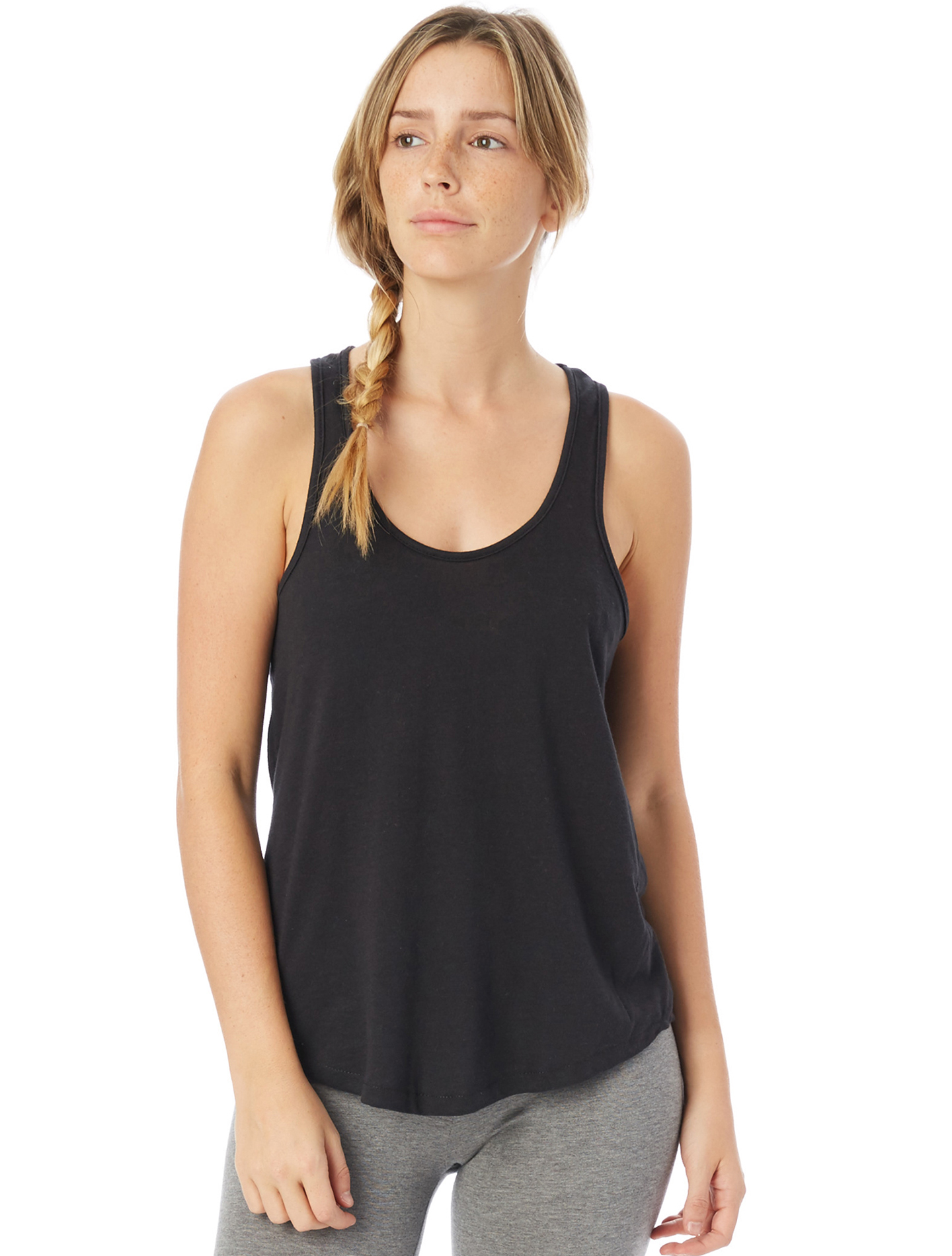 Its the kind of tank that feels like youve lived in itright from the first wear. A loose fit, high-low hem, and lower scoop neckline give a flattering shape, while the soft 50/50 fabric keeps it comfortable.