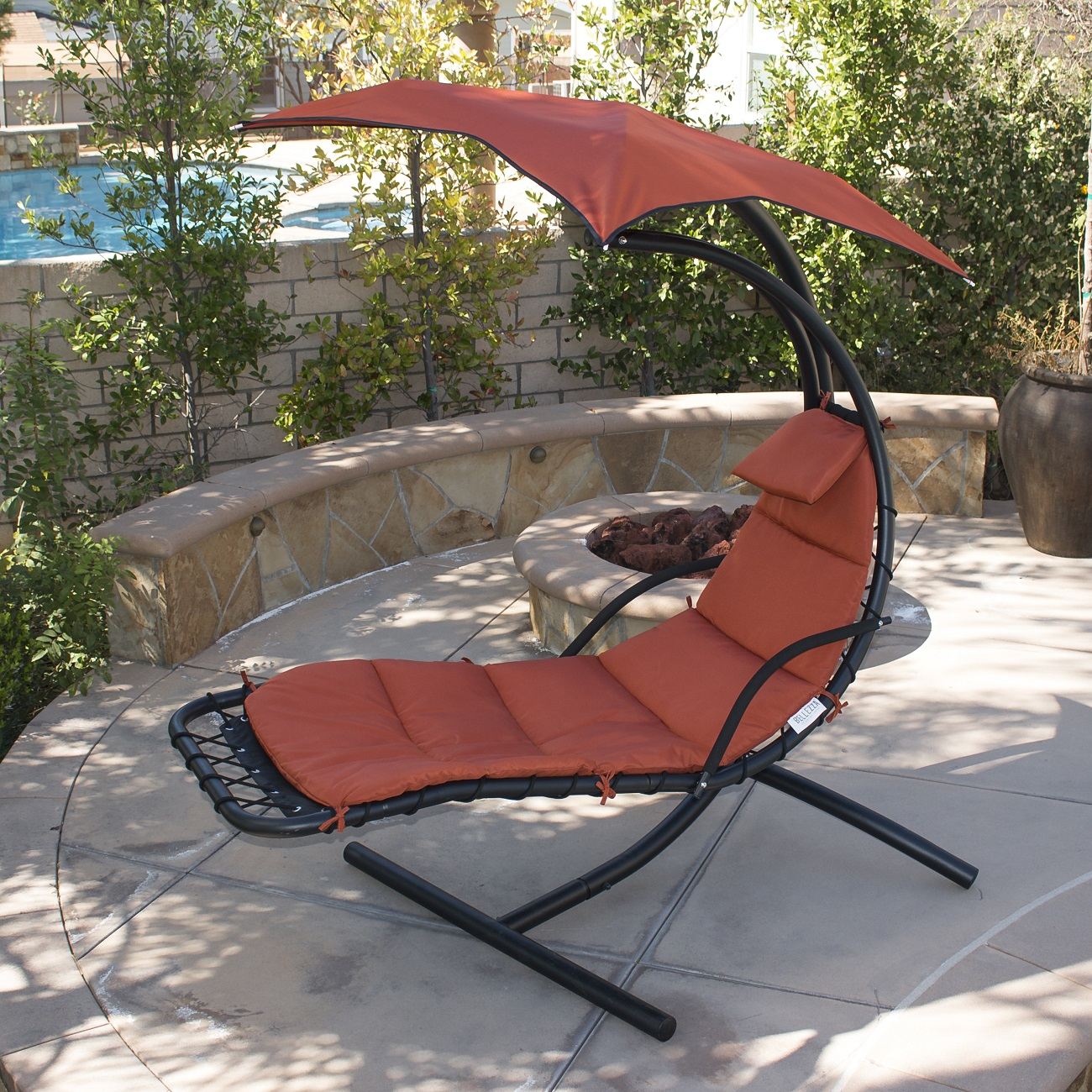 Hanging swinging lounge chair with umbrella