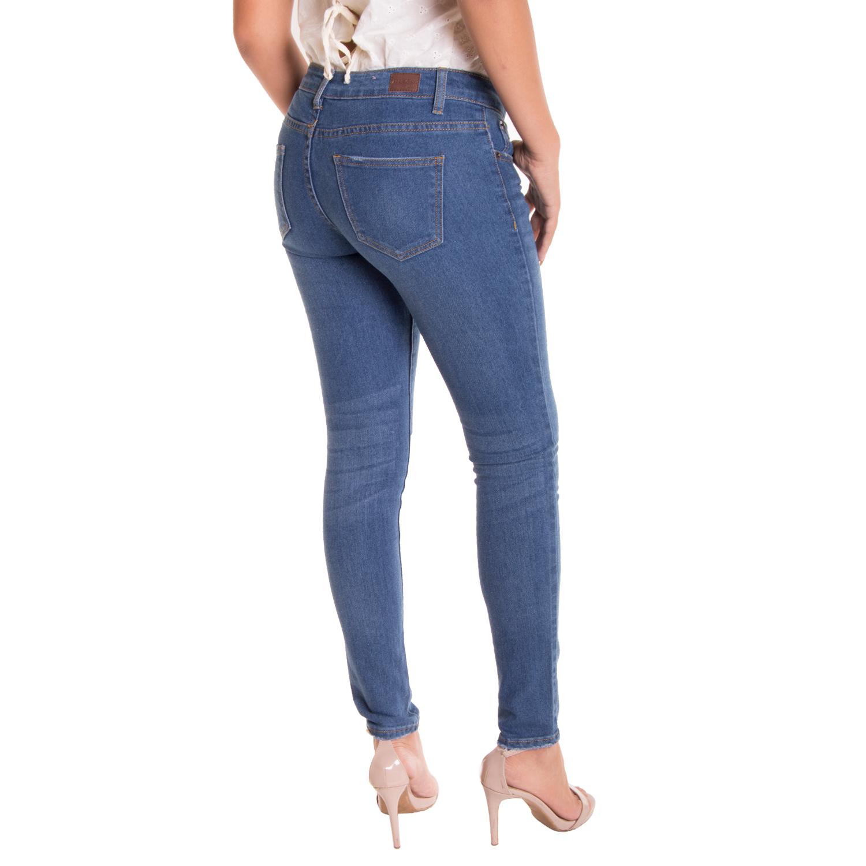 Woman paints on jeans