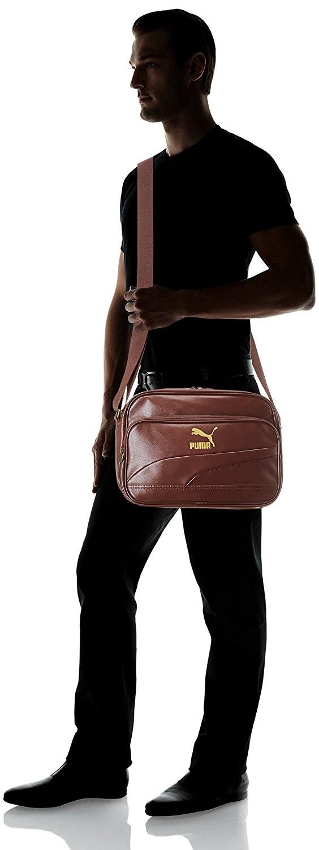 2c22c07d715b Our Price   65.99   FREE Shipping! ITEM DESCRIPTION. PUMA Reporter Bag