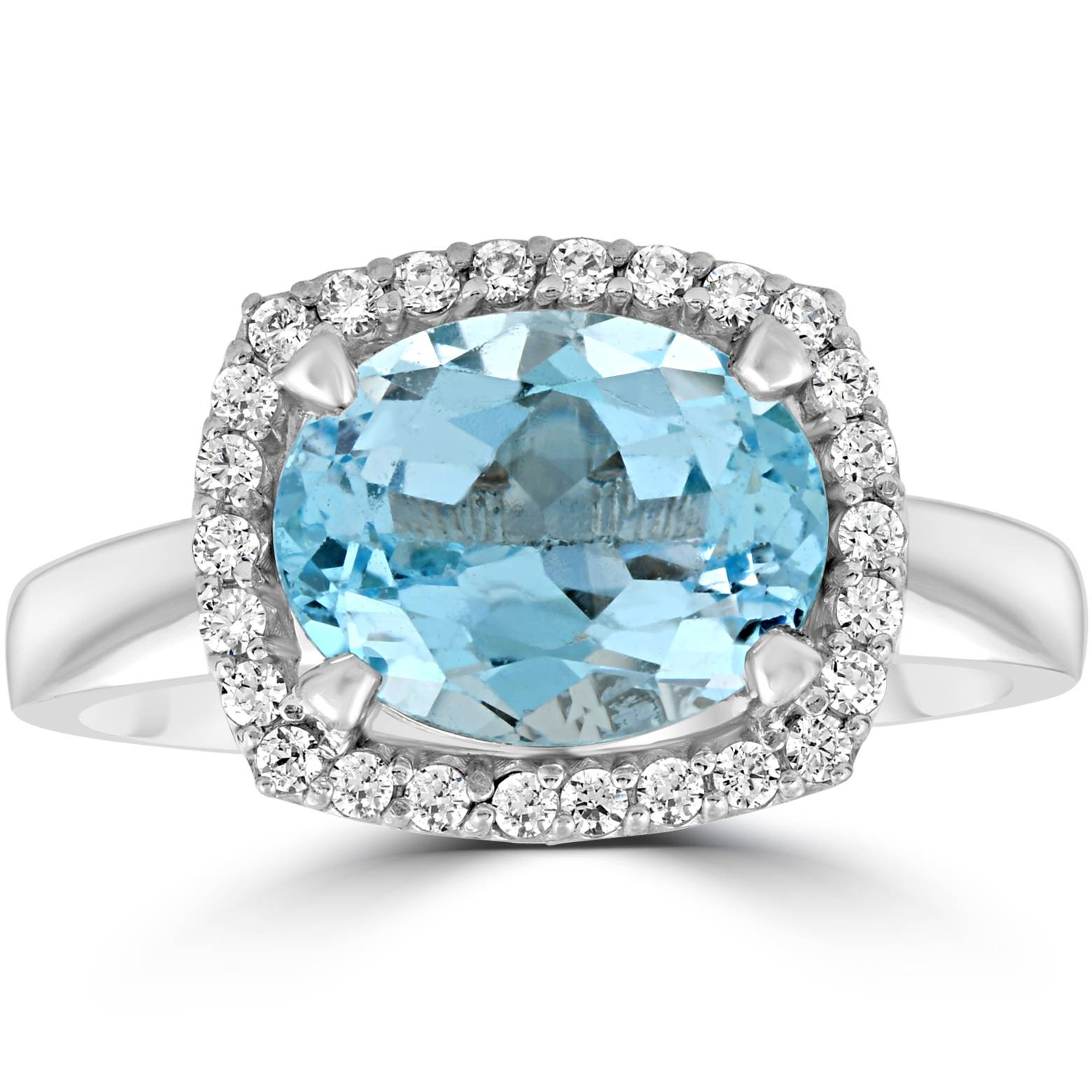 2ct oval blue topaz and halo ring 10k